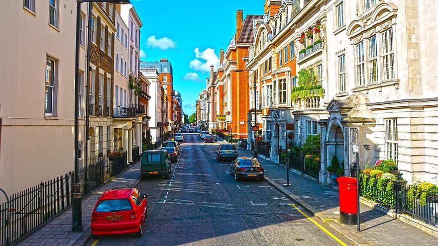 street london england city traffic people europe architecture