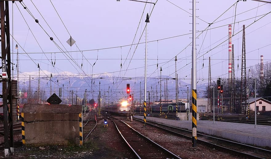 railway station evening travel transport track traffic lights wires electrified